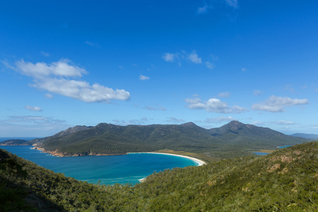 View over turquoise waters of Wineglass Bay, Tasmanias famous east coast in Freycinet National Park, Tasmania island, Australia