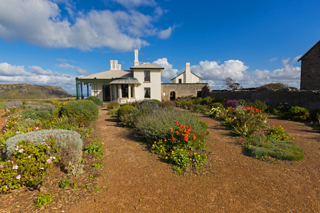TASMANIA, AUSTRALIA - APRIL 16, 2017 : Beautiful garden full of colorful flowers at Historic Highfield House in Stanley, Tasmania Australia on April 16, 2017. House was built for Van Diemens Land company by convicts between 1832-35. Editorial