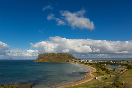 View of the Nut, old volcanic plug of basalt with the height of 143 meters rising from the ocean, and Stanley town, small port. View from Highfield lookout, Tasmania Australia Stock Photo