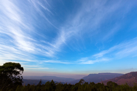 australasia: Beautiful gradient of blue purply sky of mountains range, view from Liffey Forest Lookout platform on Highland Lakes Road in evening view. Autumn in Tasmania, Australia