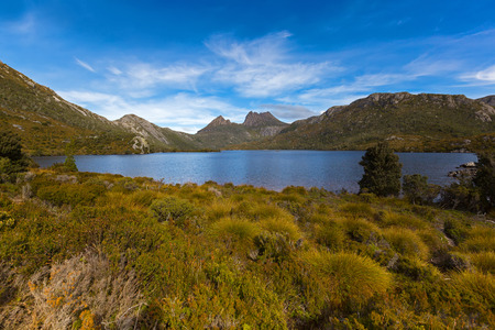 View of Dove Lake across buttongrass moorland with Cradle Mountain in background at Lake St Clair National Park. Autumn in Tasmania, Australia Stock Photo