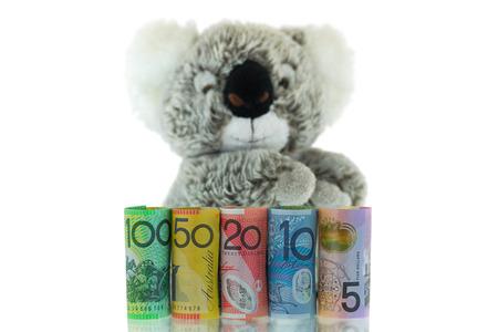 Rolls of Australia Banknote with blurred Koala background. Different Australian 5, 10, 20, 50, 100 dollars money isolated on white background Stock Photo