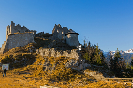 REUTTE, AUSTRIA - DECEMBER 2016: People standing at Ehrenberg Castle ruins from the south side on December 29, 2016 in Reutte in Tyrol, Austria