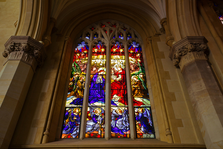 PERTH, AUSTRALIA - FEBRUARY 2018 : Colorful Stained glass at Saint Marys Cathedral, Victoria Square, in Perth, Australia on February 24, 2018. St. Mary is officially Cathedral of the Immaculate Conception of the Blessed Virgin Mary. Редакционное