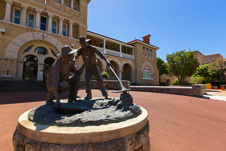 PERTH, AUSTRALIA - FEBRUARY 2018 : Bronze statue of The Strike, first discovery of gold in front of Perth Mint on Hay Street in Perth, Western Australia on February 24, 2018. Made by a sculptor, Greg James