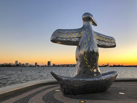 PERTH, AUSTRALIA - FEBRUARY 2018 : Big Penguin in a boat sculpture at Elizabeth Quay in Perth, Australia on February 24, 2018. It represents the arrival of British settlers in 1829.