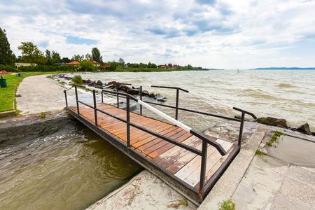 Bridge at Lake Balaton, freshwater lake in Transdanubian region in western Hungary, the largest lake in Central Europe Фото со стока