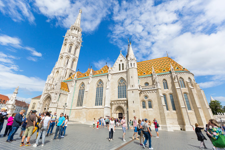 BUDAPEST, HUNGARY - JULY 2018 : People walking in front of Matthias Church, Church of Our Lady of Buda, in Budapest, Hungary on July 19, 2018