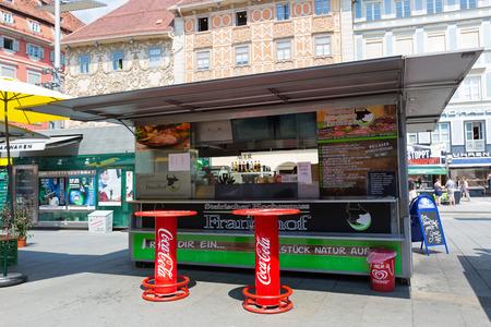 GRAZ, AUSTRIA - JULY 2018 : Austrian fast food shop, sausage stand in Graz, Austria on July 20, 2018. Its called Schnellimbiss in German language
