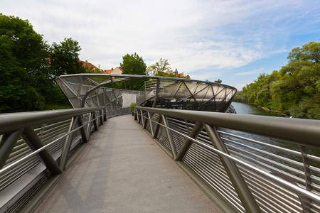 GRAZ, AUSTRIA - JULY 2018 : Murinsel bridge across Mur river in Graz, Austria on July 20, 2018. It is an artificial floating island.