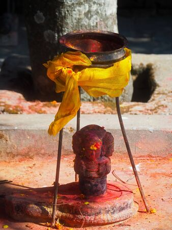 Shrine covered in vermillion to worship Goddess Kali. Red pigment powder on statue, part of Kali Shrine on the mountain in Dhulikhel, Nepal Stock Photo - 132076578