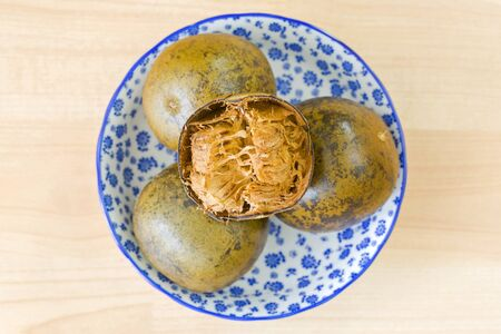 Balls of dried Monk fruit (Luo han guo) sweet fruit used to make cooling drinks in traditional Chinese medicine (Siraitia grosvenorii)