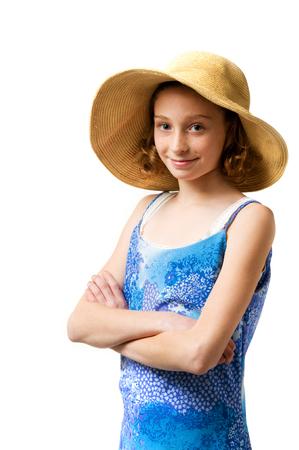 sweet young girl wearing a big floppy sunhat