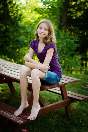 natureal: beautiful blue eyed teen girl outdoors in the summer Stock Photo
