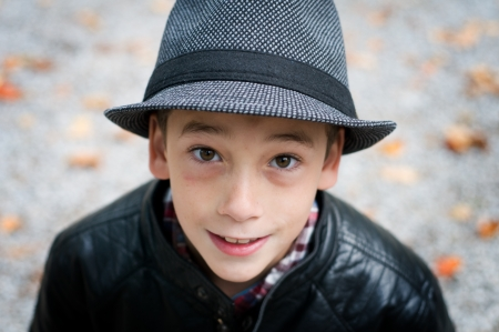 9 year old: smiling 9 year old boy wearing a fedora hat Stock Photo