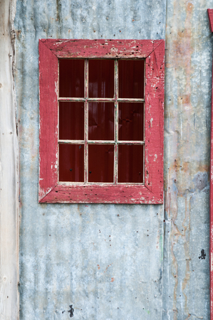 old rustic door with a red window