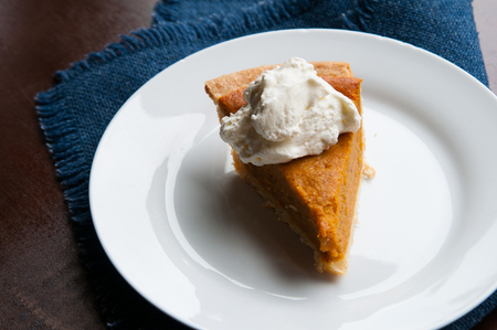 piece of pumpkin pie on a plate with a dolop of whipped cream Stock fotó