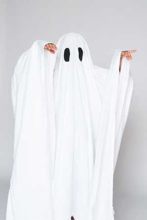 young child dressed in a ghost costume for halloween Stock Photo