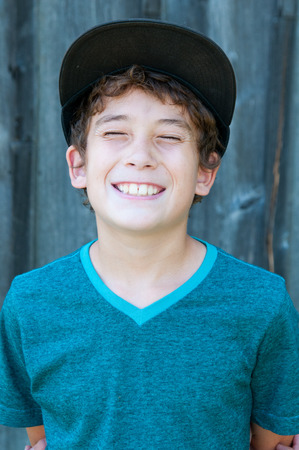 fake smile: close up of a young boy with a big fake smile Stock Photo