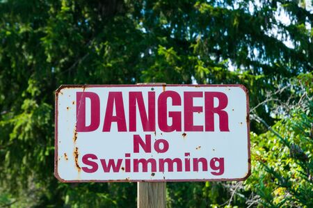 no swimming sign: a danger no swimming sign