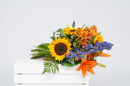 beautiful bouquet of fall flowers on a white crate Stock Photo