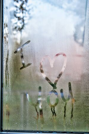 i love you written in condensation on a window