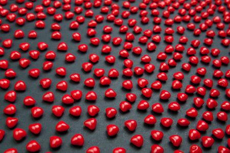 cinnimon: Red cinnimon candy hearts for valentines day on a dark background