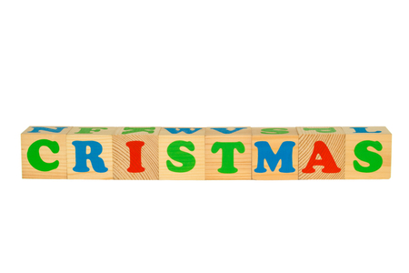 cristmas: Wood cube with inscription CRISTMAS isolated on a white background Stock Photo