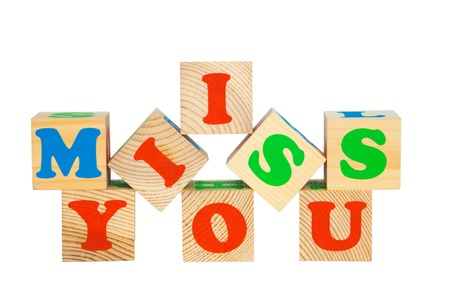 i miss you: Wood cube with inscription I MISS YOU isolated on a white background Stock Photo