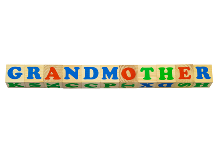 made to order: Wood cube with inscription GRANDMOTHER isolated on a white background