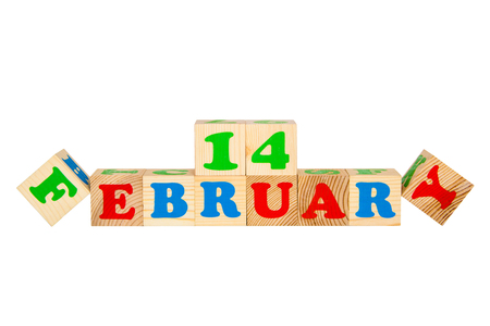 14 february: Wood cube with inscription 14 february isolated on a white background