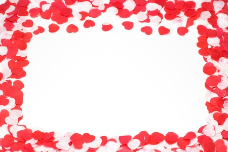 Greeting card Valentines day scattered paper red and white hearts on a white background