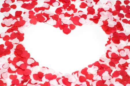 emplate: Greeting card Valentines day scattered paper red and white hearts on a white background