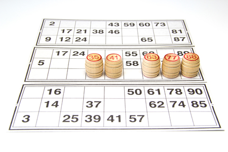 kegs: Wooden kegs and cards  for lotto or bingo game on white background Stock Photo