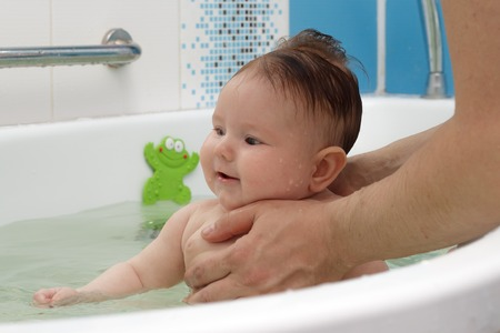 Newborn Baby Bathe And Swim In A Large Tub Stock Photo, Picture And ...