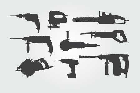 Set of hand power tools. Vector silhouettes. Stock Illustratie