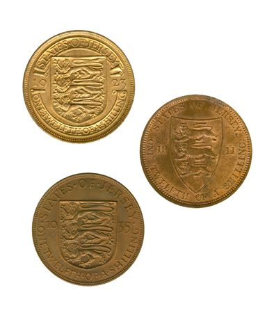 shilling: Three gold jersey coins of one twelfth of a shilling on white background