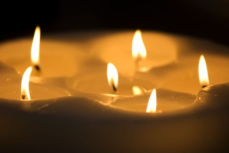 Some beautiful candles standing on the floor
