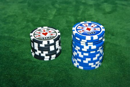Poker table with 50 and 100 dollar chips on it Stock Photo - 3745108