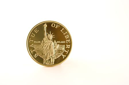Golden plated coin witn Statue of Liberty