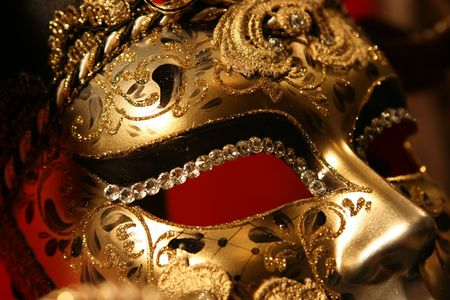 mardi gras mask: Venetian mask on red background Stock Photo