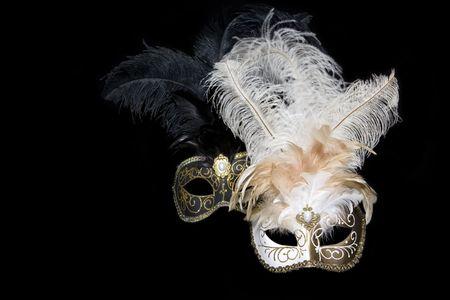 Venetian masks on black background