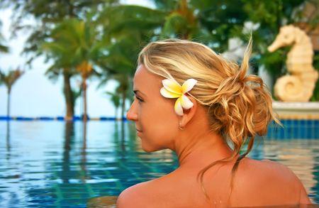 Pretty girl in spa salon under open sky