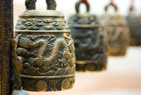 Four antique tibet bells with illustrated dragon photo