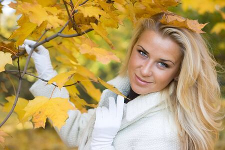 Beauty blond lady in the autumn maple forest Stock Photo