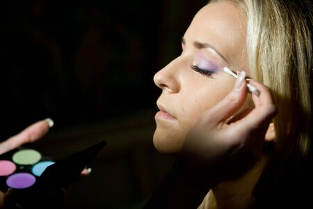 Make-up specialist working on a blond girl Stock Photo