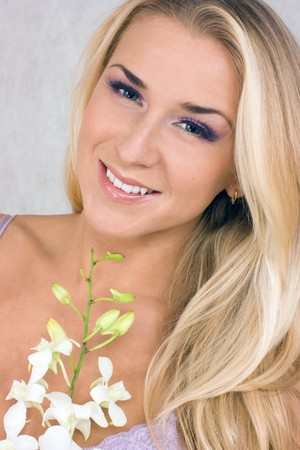 Blond girl with orchid in studio shot Stock Photo - 4322541