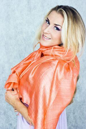 red scarf: Blond beauty in silk scarf in studio shot