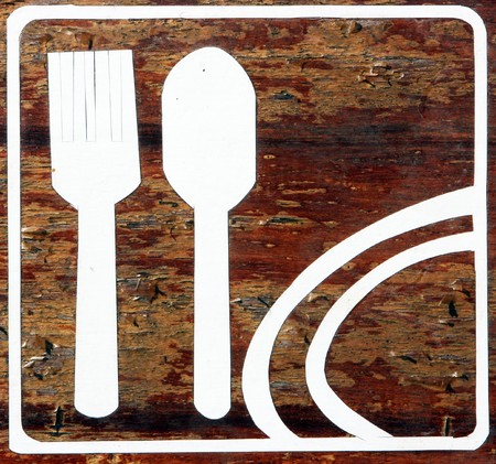 Restaurant sign painted on wooden board