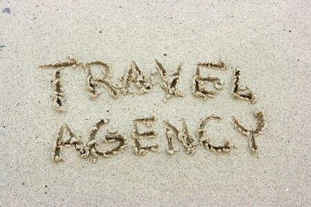 Travel agency inscription on the sand beach Stock Photo